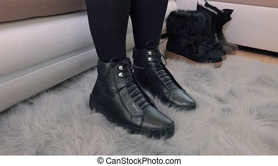 Woman moving legs and checking new boots