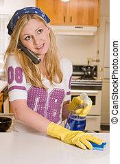 Woman multi tasking - Blond caucasian woman wearing yellow...