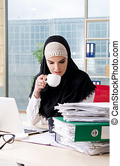 Woman muslim employee working in the office