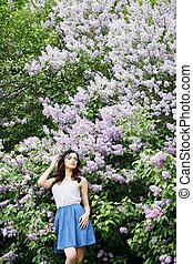 woman near a lilac