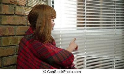 Woman near a window