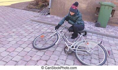 Woman near bicycle in yard