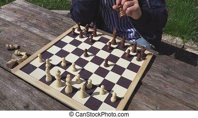 Woman near chess board