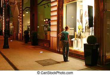 Woman near clothing store window