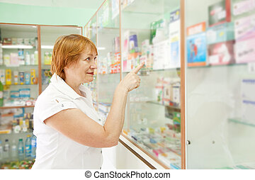 woman near counter in drugstore