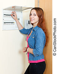 Woman near power control panel