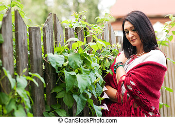 Woman near the fence