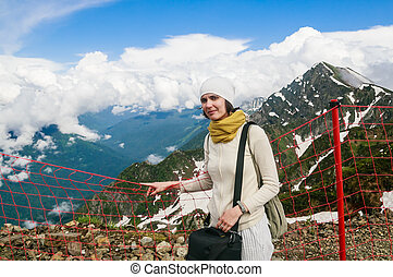 Woman near the fence on the ski slopes in summer. Ski resort Sochi. Russia