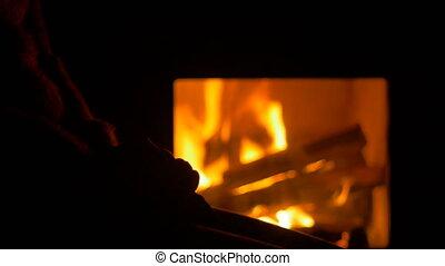 Woman near the Fireplace