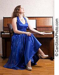 woman near the piano