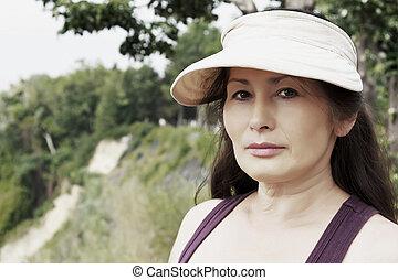 Woman near the sea in a public park