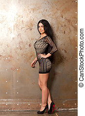 Woman near the wall
