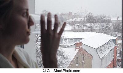 Woman near the window