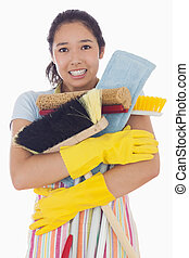 Woman nearly dropping her cleaning tools - Woman narly ...