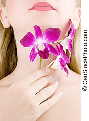 Woman neck and hand with flower
