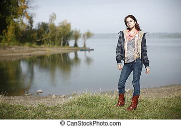 Woman next to a lake