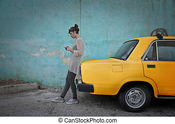 Woman next to taxi
