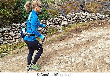 Woman nordic walking