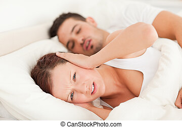 Woman not wanting to hear snoring in the bedroom
