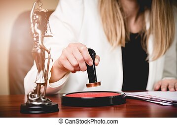 Woman Notary Public stamping the Power of attorney. Law...