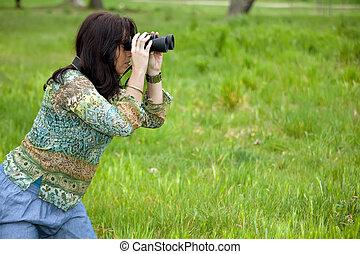 woman observing wildlife