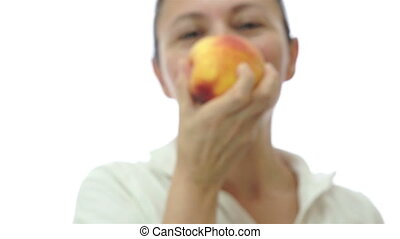 Woman Offering a Bite of Her Peach