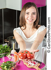 Woman offers tomatoes