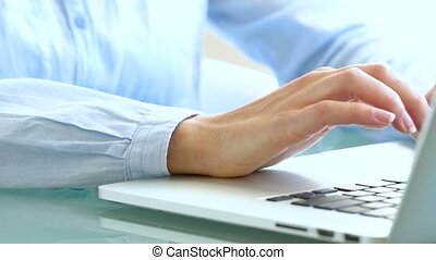 Woman office worker typing on the keyboard - Female hands or...