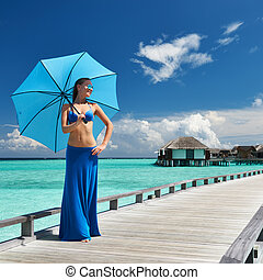 Woman on a beach jetty at Maldives - Woman on a tropical ...