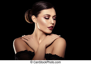 Woman on a black background. Beautiful bright fashion model. Beauty girl. Luxurious lady with a stylish make-up and manicure.