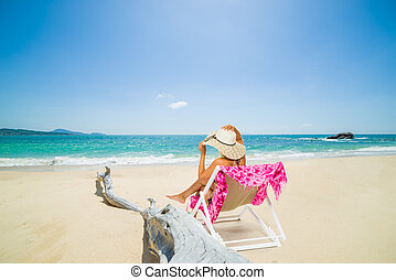 Woman on a deck chair at the beach