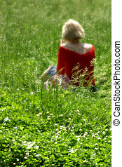 woman on a glade - The woman sitting on a glade. A software...