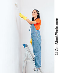 Woman on a Ladder Painting the Wall at Home
