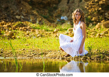 Woman on a river bank