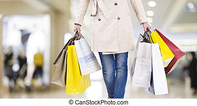 woman on a shopping spree - woman with colorful shopping...