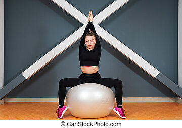 woman on a sports ball