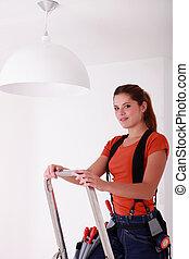 Woman on a stepladder