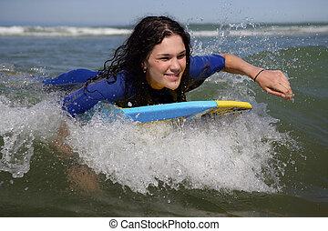 Woman on a surfboard