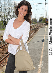 Woman on a train platform