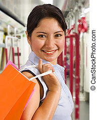 Woman On A Train With Shopping