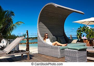 Woman on a tropical beach jetty