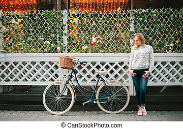 Woman on a Vintage Bicycle at the Street