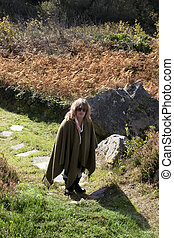 woman on a walk at pilgrimage site in Ireland