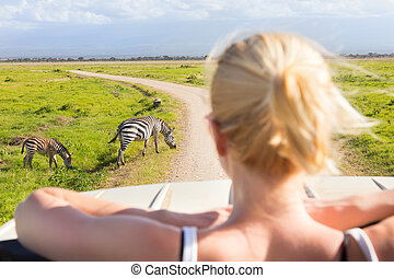 Woman on african wildlife safari. - Woman on african ...