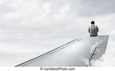 Woman on airplane wing