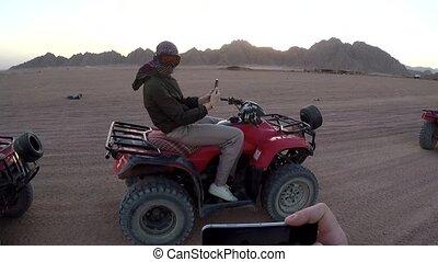 Woman on an ATV in the Egyptian desert