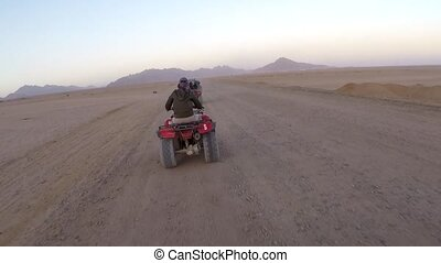 Woman on an ATV in the Egyptian desert