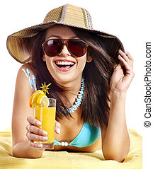 Woman on beach drinking cocktail. - Happy woman on beach ...