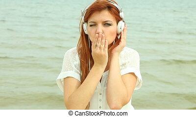 Woman on Beach Listening to Music