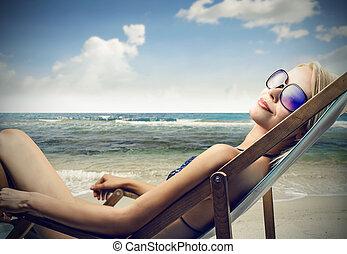 Woman on beach - Woman sitting on beach